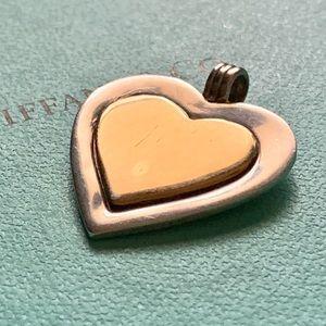 Tiffany 18k gold heart on a silver heart pendant